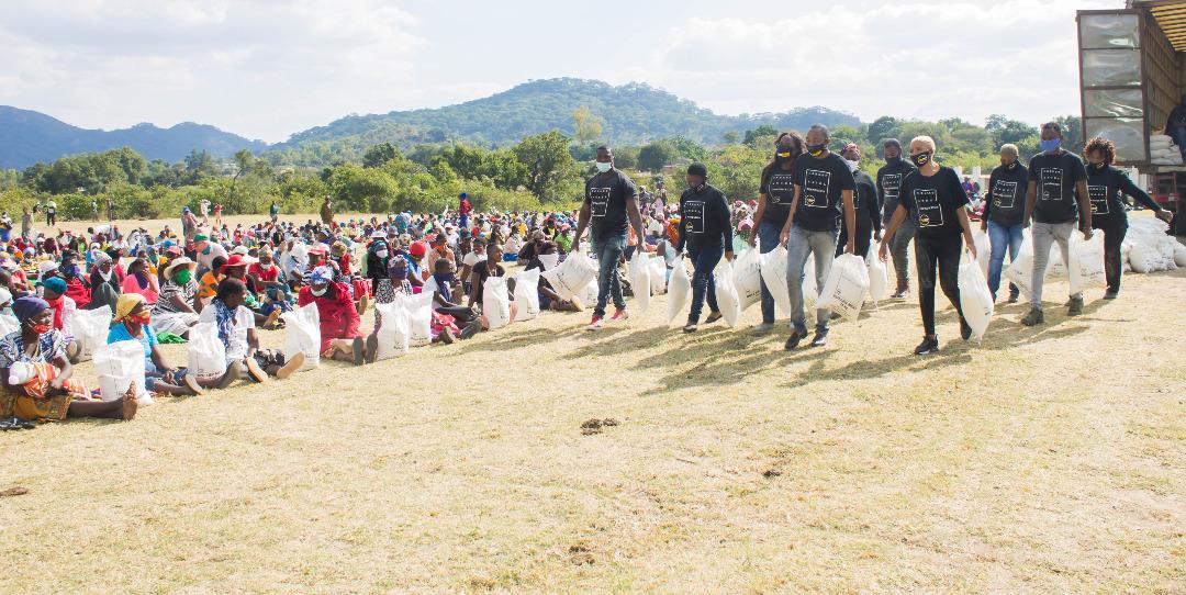 Prophet Uebert Angel donates truckloads of mealie meal in Zaka, Masvingo
