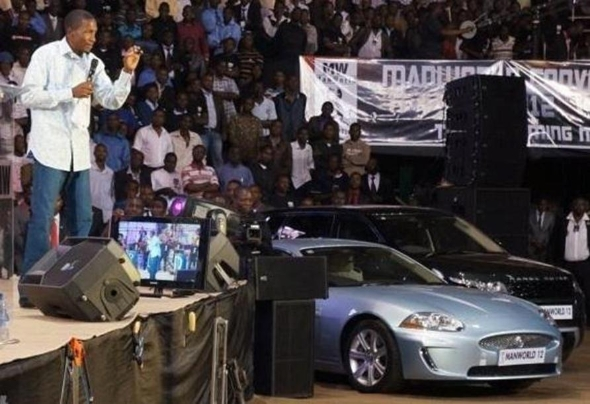 Prophet Uebert Angel preaches with a Range Rover and what looks like a ...