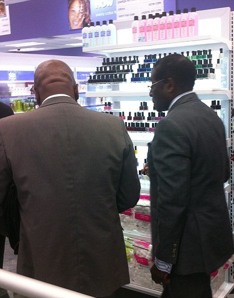 Mugabe lipstick shopping: Mugabe browses the lipsticks in Duane Reade on 52nd Street, a downtown drugstore in New York