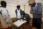 Policeman looks at a voter in this file photo