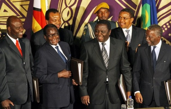 (FromL) Zimbabwe's new Deputy Prime Minister Arthur Mutambara, Zimbabwe President Robert Mugabe, new Prime Minister Morgan Tsvangirai and South African President Thabo Mbeki pose on the first row with King Mswati III of Swaziland (L) and Tanzania's President Jakaya Kikwete (R), after signing the power-sharing accord on September 15, 2008 in Harare.