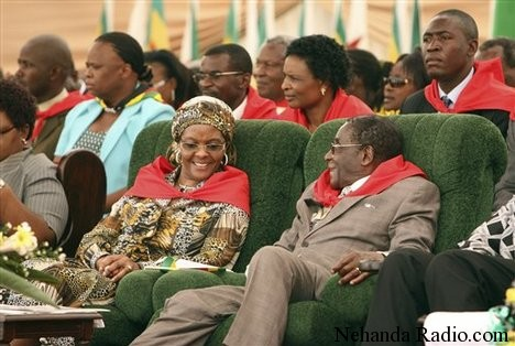 Wife Snatcher: Dictator Mugabe smiles with stolen wife Grace