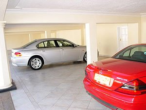 Philip Chiyangwa and his garage full of cars