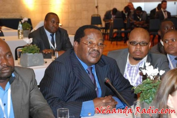 Mines Minister Obert Mpofu (centre) is a man of significant means