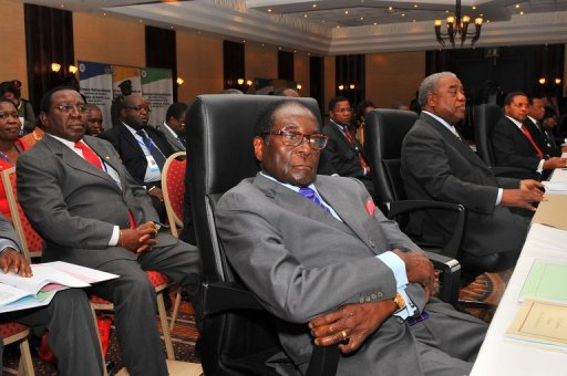 Robert Mugabe struggles to stay awake at a SADC Summit in Sandton, South Africa