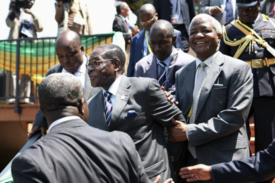 Robert Mugabe's ailing health has seen him become the Commander in Slip. The 87 year old dictator now requires help to walk.