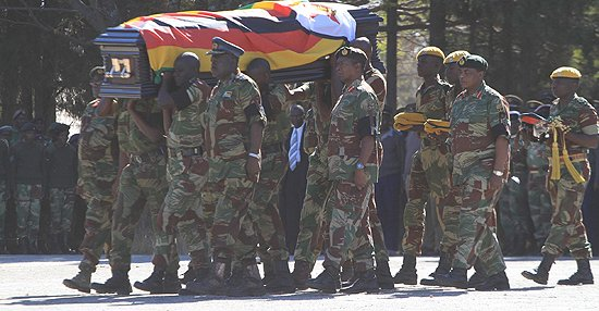 AIR Force Commander Air Marshal Perrance Shiri, Zimbabwe National Army Commander Lieutenant-General Phillip Sibanda and Zimbabwe Defence Forces Commander General Constantine Chiwengwa lead the funeral parade in honour of General Solomon Mujuru at One Commando Barracks in Harare