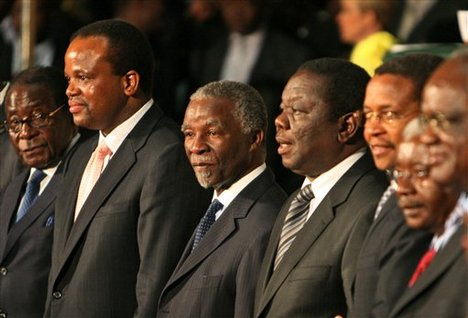 Mugabe (left) looks nervously at fellow Southern African leaders