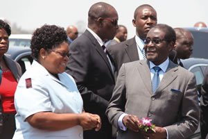 Vice President Joice Mujuru meets Mugabe at the airport