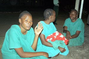 The three suspected female rapists — Netsai Nhokwara, Rosemary Chakwizira and Sophie Nhokwara — shy away from the camera before their release from Chikurubi Maximum Security Prison yesterday