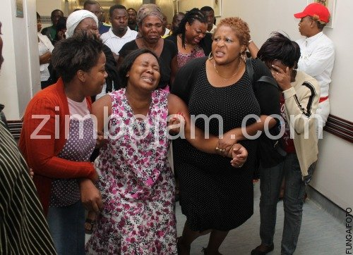 Tongai Moyo wife Miniehle Mukweli being consoled