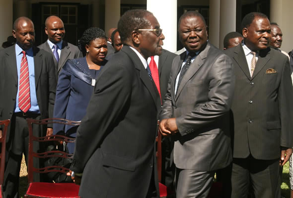 Mugabe absence paralyses government