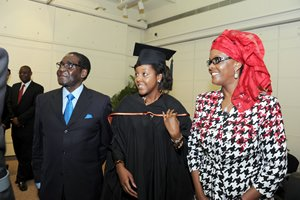 President Mugabe and the First Lady Amai Grace Mugabe pose for a photograph with their daughter Bona who graduated with a Bachelor of Business Administration (Honours) Degree in Accountancy at City University in Hong Kong on Monday