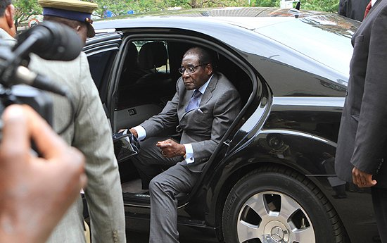 The 87 year old Zanu PF leader stepped out of his armoured Mercedes limousine and handed the bag over to one of his bodyguards (picture by New Zimbabwe.com)