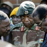 The head of Zimbabwe Central Intelligence Happyton Bonyongwe, left, with Constantine Chiwenga, the commander of the Zimbabwean Army, centre, with Mugabe