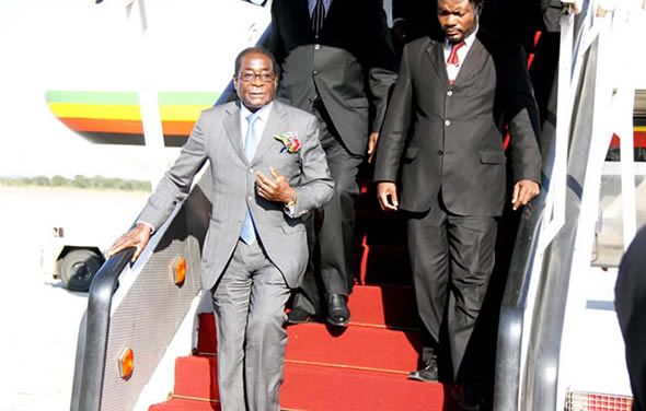 Mugabe in another Singapore trip