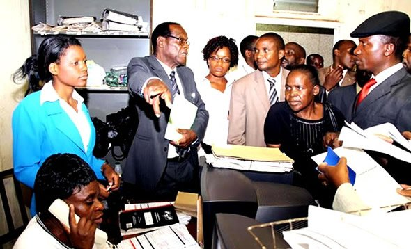 Mugabe's trusted election rigger: Registra General Tobaiwa Mudede (in glasses)