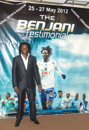 Former Warriors captain Benjani Mwaruwari stands besides a banner promoting his testimonial at a Press conference to announce details of the event in Harare yesterday