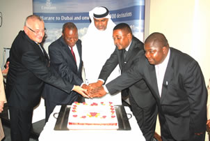 Tapiwa Mashakada (right) and Walter Mzembi to the left welcome Emirates into Zimbabwe
