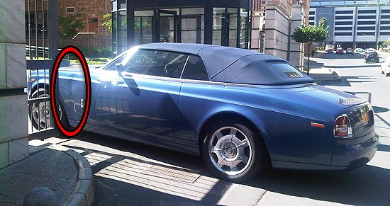 When the electric gate to Buyanga's apartments (in SA) unexpectedly closed as he was driving in, and left a dent on his £300,000 soft-top Rolls-Royce, he parked his expensive motor in the gateway – blocking all traffic.