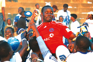 Jubilant Dynamos supporters hoist goalkeeper Washington Arubi after his heroics helped the Glamour Boys to victory over Gunners at Lafarge