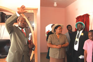 Chief Kasekete's brother Mr Wilson Mutinhima shows Acting President Joice Mujuru the house Prophet Emmanuel Makandiwa built for the chief in Muzarabani yesterday. Looking on is the chief and other guests