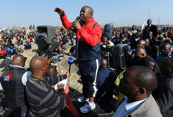 Former African National Congress' Youth League leader Julius Malema addresses platinium miners at London-listed Lonmin's Marikana platinum mine Photo: AFP