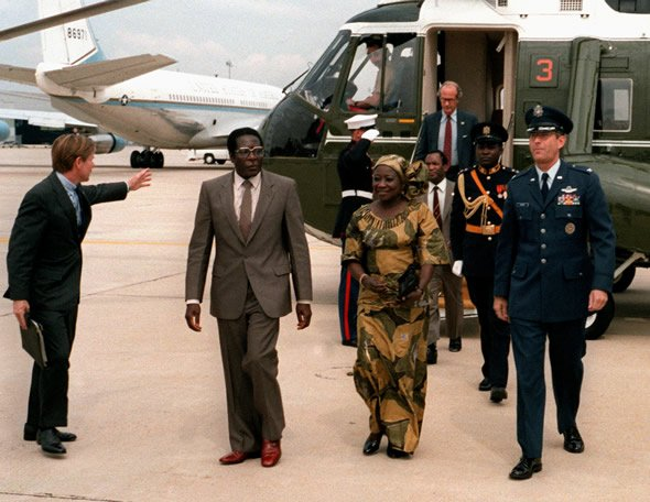 Prime Minister Robert Mugabe of Zimbabwe departs Andrews Air Force Base after a state visit to the United States (26 September 1983)