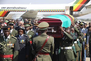 Pallbearers carry the casket bearing the body of former Zambian first lady Mrs Betty Kaunda on arrival at Kenneth Kaunda International Airport in Lusaka, Zambia, yesterday.