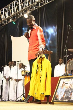 Emmanuel Makandiwa holds fellow prophet Uebert Angel's shirt which was auctioned for a whooping US$10 000.