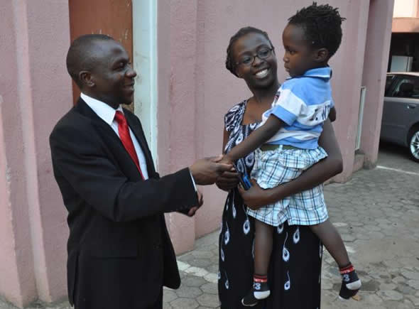 Human rights campaigner Cynthia Manjoro chats with her lawyer Gift Mtisi and son, David, after her release from Chikurubi Prison on Wednesday 17 October 2012. (Picture by Zimbabwe Lawyers for Human Rights)