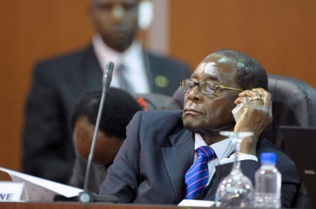 OLD & TIRED: Mugabe takes a nap
