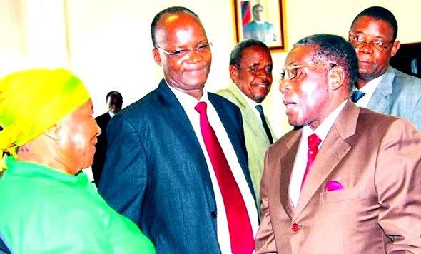 Jonathan Moyo seen here with Mugabe
