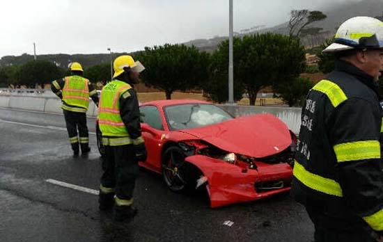 First responders ... Rescue crews attend to Buyanga's stricken Ferrari in Cape Town