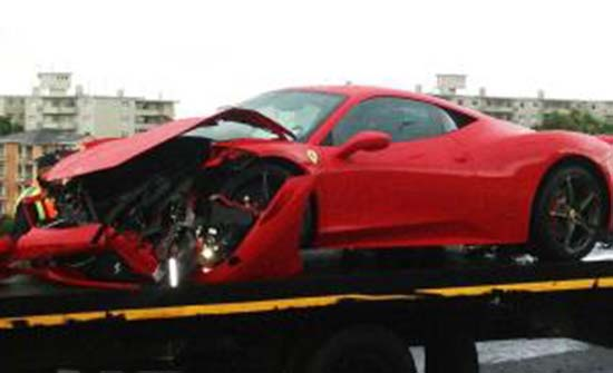 Wreckage ... Millionaire playboy Frank Buyanga's heavily-damaged Ferrari being towed away