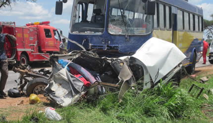 A passerby views the wreckage of a Toyota Hilux which collided head-on with a Zupco bus along the Kwekwe-Gweru Road yesterday morning, killing four people on the spot.