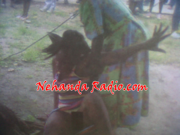 Chipo Maruta being restrained by her mother