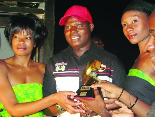 The late Tongai Moyo seen here receiving a Nama Award