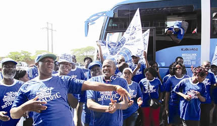 BLUE ARMY . . . Dynamos fans sing and dance in Harare yesterday shortly before leaving for Lesotho to support their team in tomorrow's Champions League tie