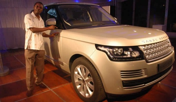 "Alick Macheso poses with the all new Range Rover SUV. — (Picture by Takawira ""Photovet"" Dapi"