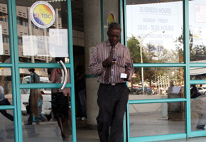 An unidentified man reads his prepaid 
