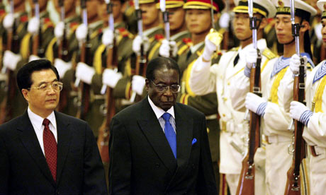 Robert Mugabe is welcomed to Beijing by the Chinese president, Hu Jintao