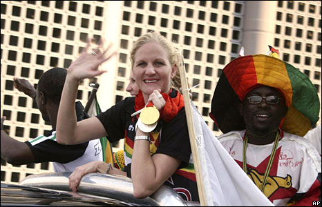 Kirsty Coventry gets a heroes welcome from one of her many winning exploits