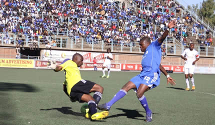TARGET MAN . . . Dynamos striker Patrick Khumbula (right) goes for goal against How Mine goalkeeper Pedzisayi Gumiremhete during yesterday's match at Rufaro