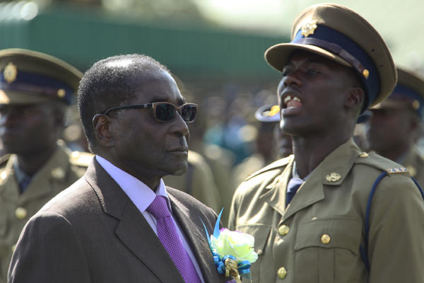 Police officers are on parade as Zimbabwean President Robert Mugabe inspects the honor guard at a police pass-out parade in Harare, Thursday, June, 13, 2013. Tsvangirayi Mukwazhi/AP
