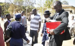 Polling officers and ZRP distributing voting material at ZANU PF Chegutu offices