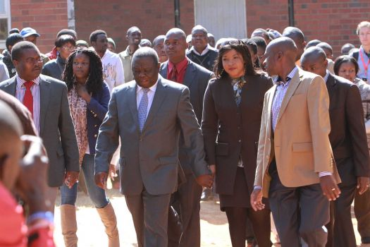 Zimbabwean Prime Minister Morgan Tsvangirai ,centre, arrives to cast his vote, accompanied by his wife Elizabeth in Harare, Wednesday, July, 31, 2013. Tsvangirai is contesting against his main rival, President Robert Mugabe in the presidential poll.