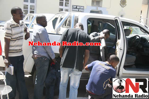 Police detectives searching a car at Mutare Centra Police station in August this year