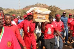 Pall bearers carry the body of the late MDC-T youth, Rebecca Mafikeni, who died while in detention after more than two years in jail