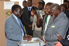 'Robbery' Mugabe voting on election day